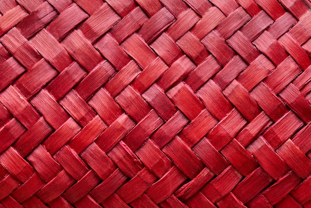 Background texture of red weaving close-up. Premium Photo