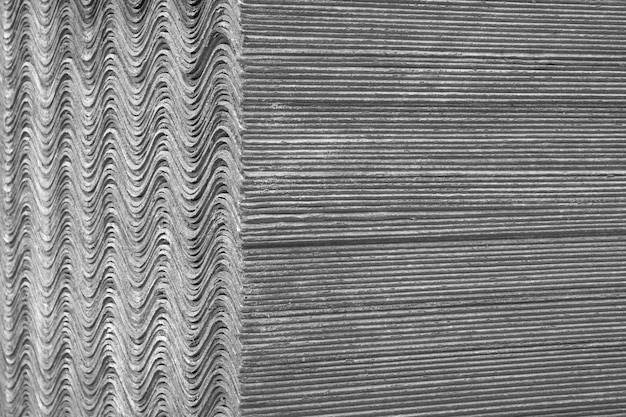 Background texture. slate sheets lie on top of each other and form a straight and undulating surface. Premium Photo