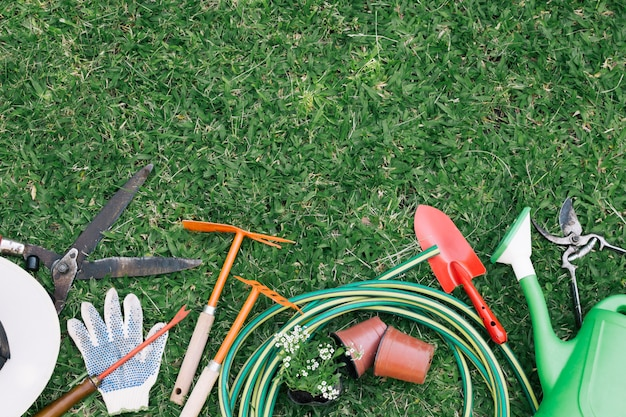 Background of tools on green grass in garden Free Photo
