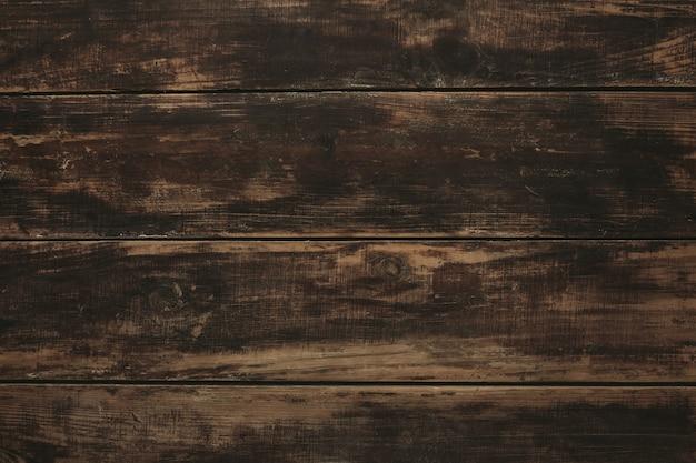 背景、古いヴィンテージの古いブラシをかけられた茶色の木製テーブルの上面図、豊かな質感 無料写真