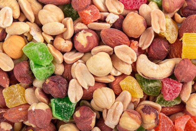 Background of various nuts and candied fruits close up Premium Photo