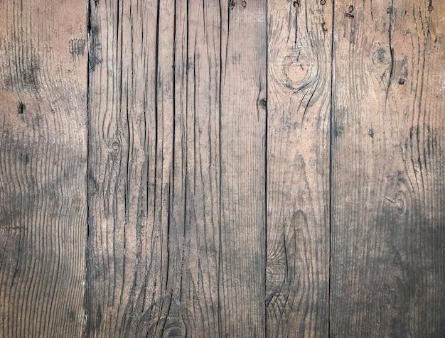 Sfondo di una superficie in legno stagionato con uno spazio di copia Foto Gratuite