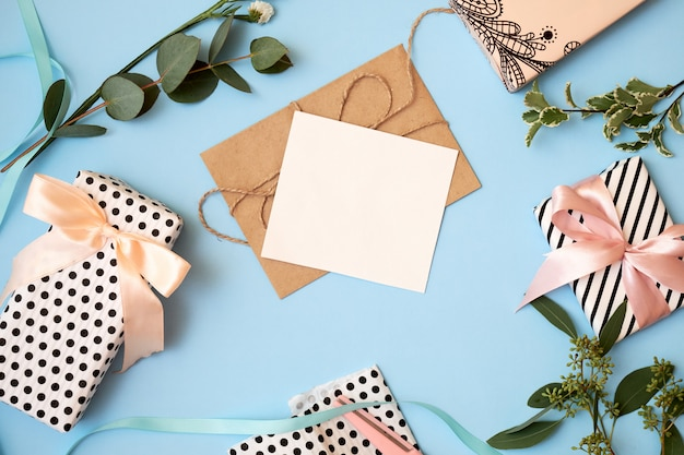 Background with envelope, greeting card and flowers. Premium Photo