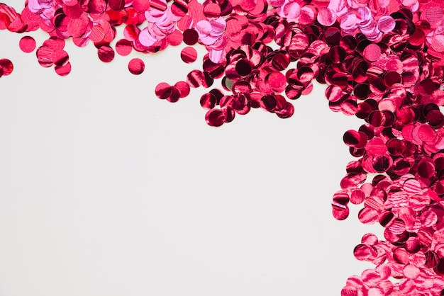 Background with pink bright confetti Free Photo