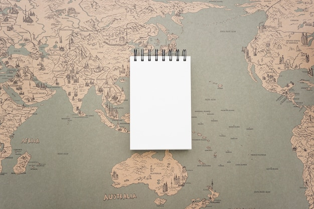 Background with vintage world map and blank notebook photo free background with vintage world map and blank notebook free photo gumiabroncs Choice Image