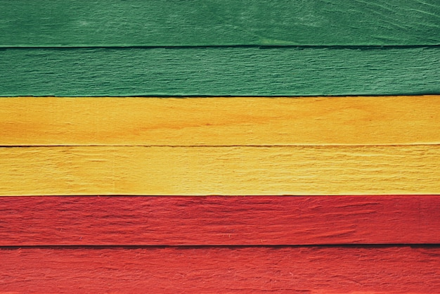 Background wood green, yellow, red old retro vintage style, rasta reggae flag Premium Photo