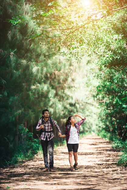 Backpack friendship beautiful looking young Free Photo