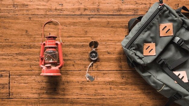 Backpack and lantern near compass Free Photo