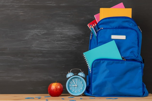 Backpack with stationery in the bag Premium Photo