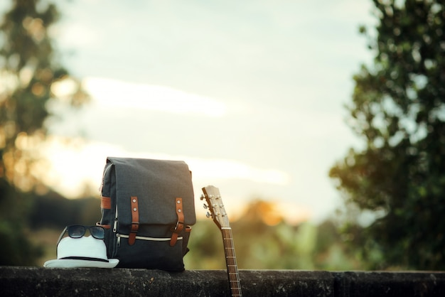 Backpack with sunset Free Photo
