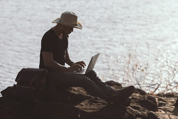 Backpacker relax on the mountain with using laptop Free Photo