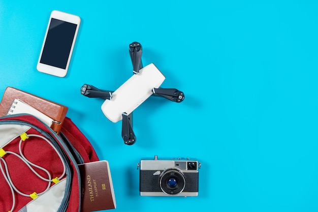 Backpacker tourist travel gadgets and objects in backpack Premium Photo