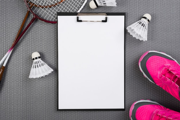 Badminton equipment with clipboard composition Free Photo