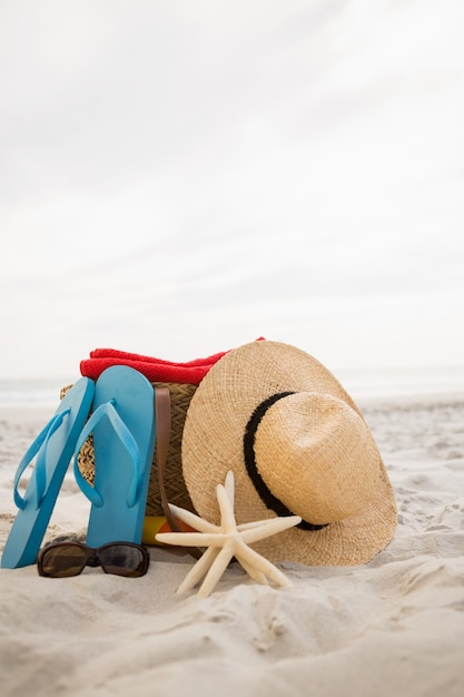 Bag and beach accessories kept on sand Photo