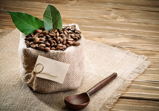 Bag of burlap filled with coffee beans Premium Photo