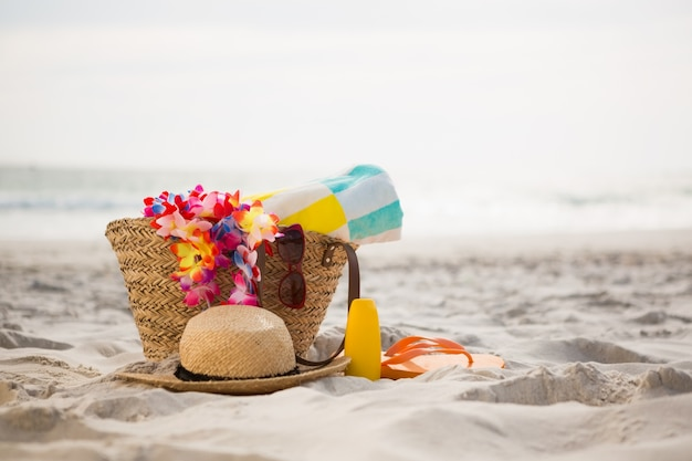 Bag with beach accessories kept on sand Photo
