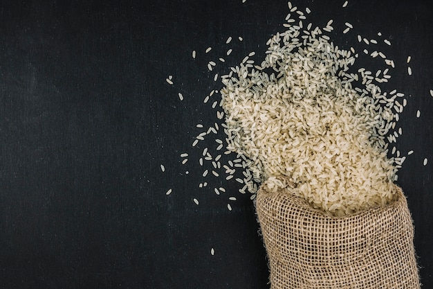 Bag with spilled rice Free Photo