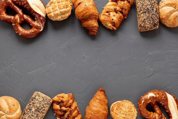 Bagels and croissants frame with copy space Free Photo