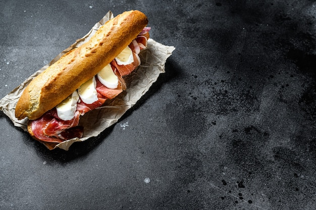 Baguette sandwich with prosciutto ham, camembert cheese Premium Photo