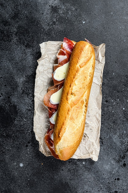 Baguette sandwich with prosciutto ham Premium Photo