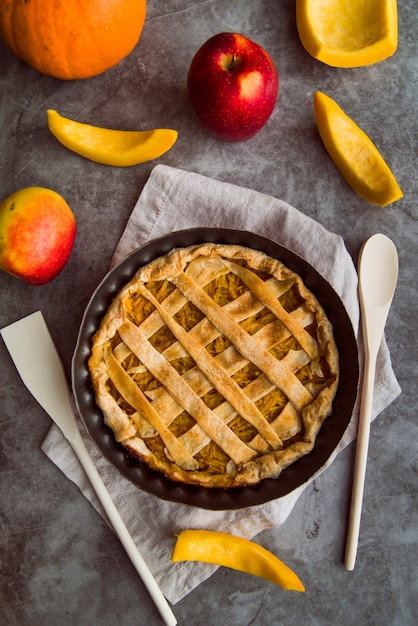 Baked apple pie on the table top view Free Photo