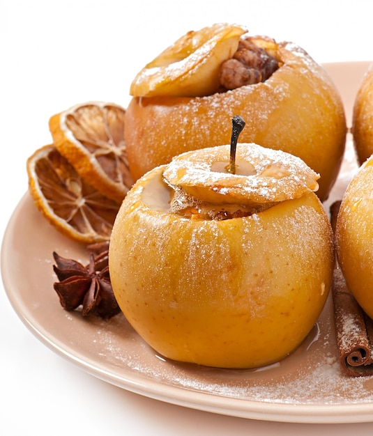 Baked apples with honey and nuts Free Photo
