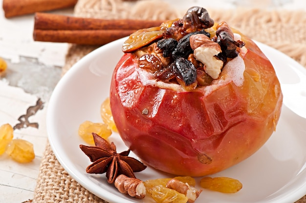 Baked apples with raisins, nuts and honey Free Photo