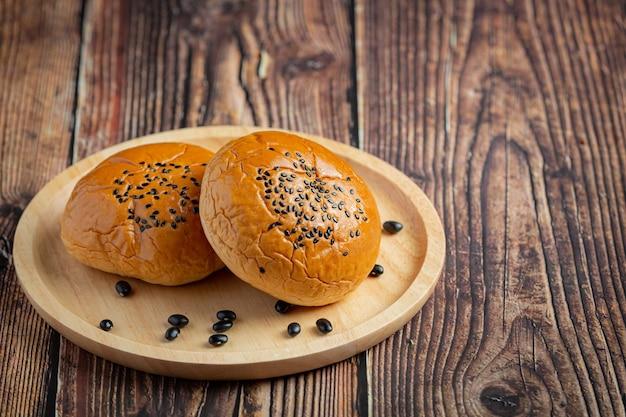 Baked black bean paste buns put on dark floor Free Photo