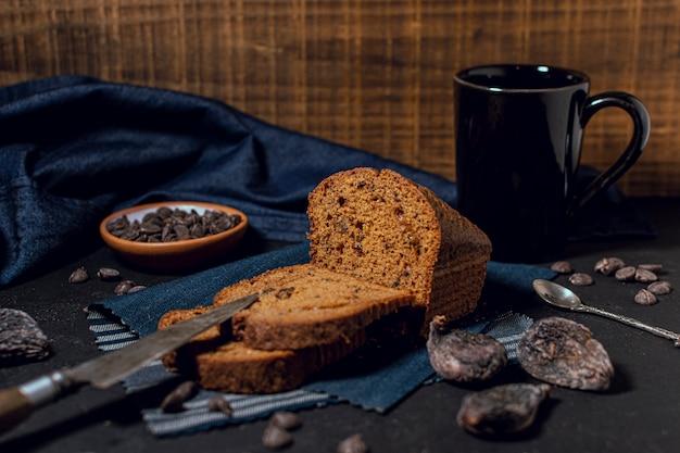 Baked cake and hot chocolate mug Free Photo
