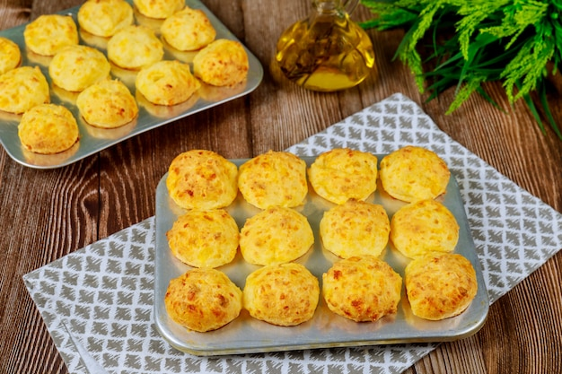 Baked cheese bread called chipa in baking tray. Premium Photo