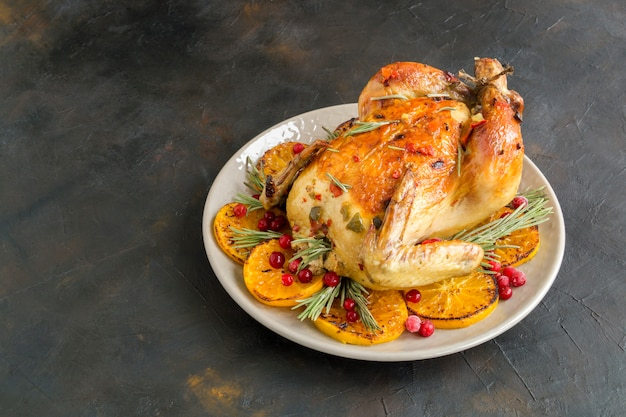 Baked chicken in the oven, festive dish, Premium Photo