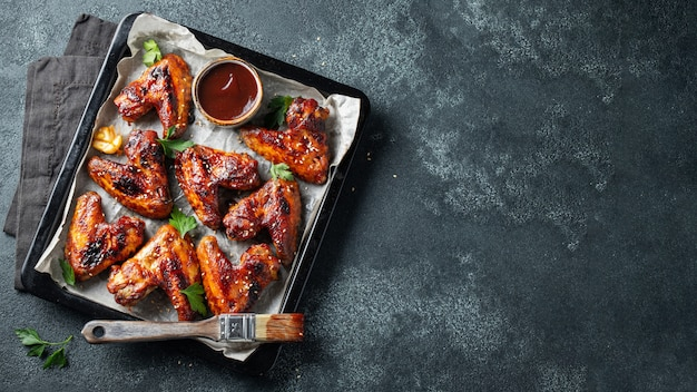 Baked chicken wings in barbecue sauce. Premium Photo