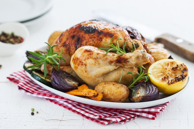 Baked chicken with lemon and vegetables Free Photo