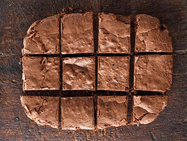 Baked  chocolate brownie pie is cut into squares Premium Photo
