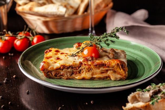 Baked lasagna with minced bolognese. Premium Photo