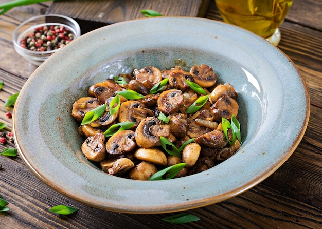 Baked mushrooms with soy sauce and herbs. vegan food. Free Photo