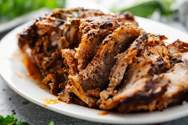 Baked pork with spices and herbs Free Photo