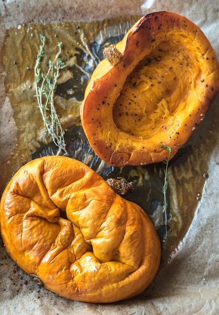 Baked pumpkin with herbs on the tray Premium Photo