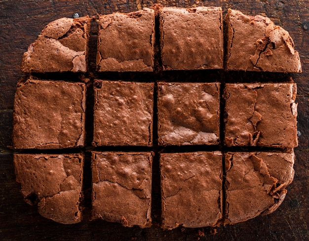 A baked rectangular chocolate brownie pie is cut into squares Premium Photo
