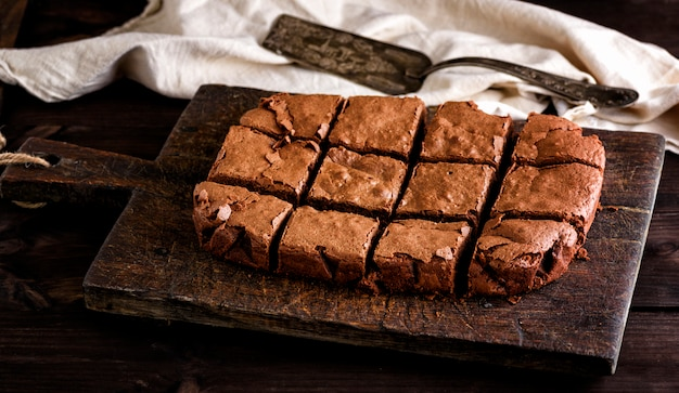 Baked rectangular chocolate brownie pie is cut into squares Premium Photo
