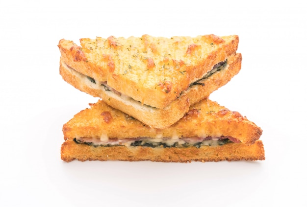 Baked spinach and ham sandwich with sauce Premium Photo