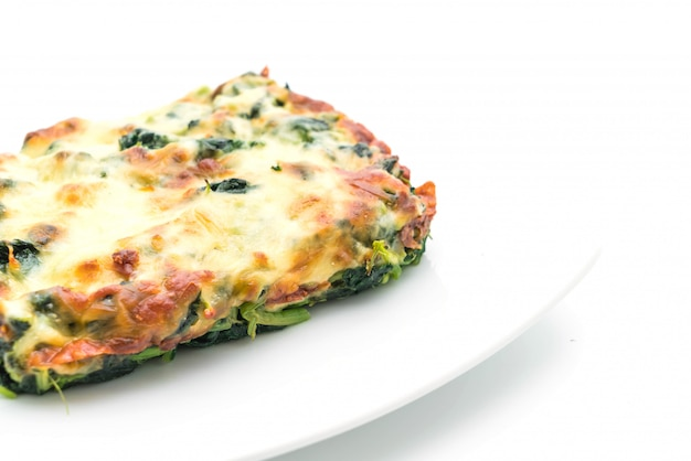 Baked spinach with cheese Premium Photo