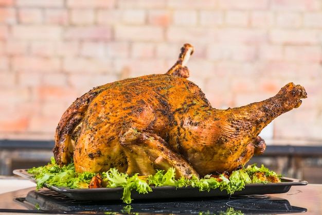 Baked turkey with lettuce on pan Free Photo
