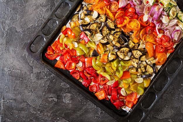 Baked vegetables on a baking sheet. Premium Photo