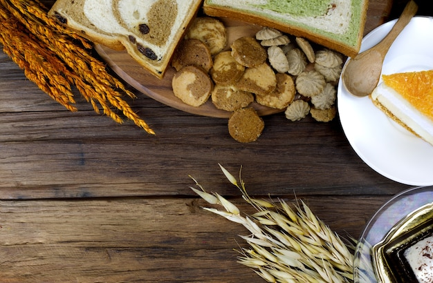 Bakery Cookie And Cake On Wooden Floor With Barley Rice Sticks