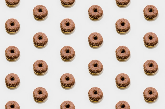 Bakery pattern with chocolate donuts Free Photo