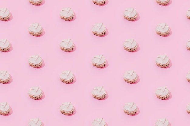 Bakery pattern with pink sweets Free Photo