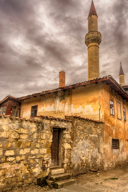 Bakhchisarai. khan's palace from the old street in cloudy weather. Premium Photo