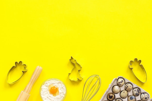 Baking easter composition. rolling pin, whisk for whipping, cookie cutters Premium Photo