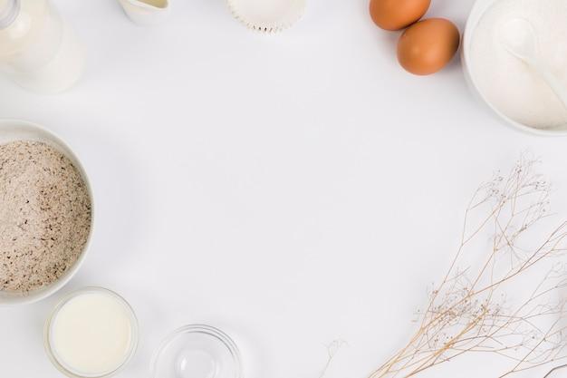 Baking ingredient in circular fame over white backdrop Free Photo